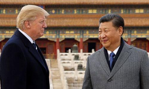 Trump (trái) và Tập Cận Bình trong chuyến thăm Bắc Kinh năm ngoái. Ảnh: AP.