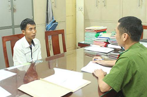 Nghi phạm Lữ Văn Thành tại trụ sở công an.