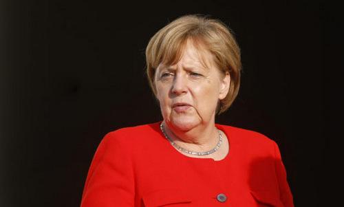 Thủ tướng Merkel trong một cuộc họp hôm 19/6. Ảnh: AFP.