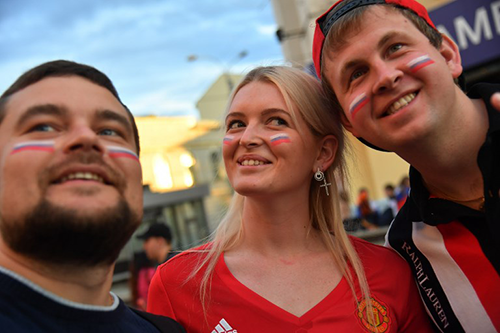 Russian fans take a selfie in Ekaterinburg on June 19, 2018 during the Russia 2018 World Cup football tournament.