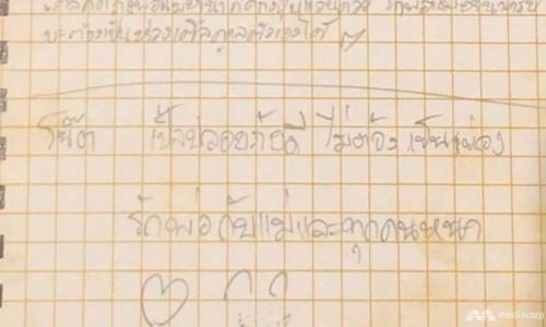 Bức thư tay của một trong 12 cậu bé kẹt trong hang Tham Luang. Ảnh: CNA.