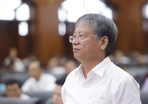 Ông Nguyễn Ngọc Tuấn trả lời ý kiến của các đại biểu. Ảnh: Nguyễn Đông.