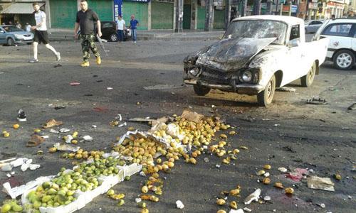 Hiện trường vụ đánh bom tự sát của chiến binh IS tại một khu chợ thuộc tỉnh Sweida hôm 25/7. Ảnh: Reuters.