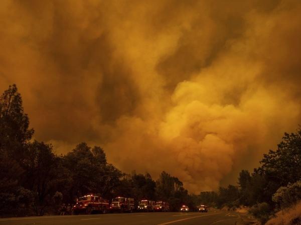 The Carr Fire burns along Highway 299 in Shasta, Calif., on Thursday, July 26, 2018.Noah Berger / AP
