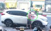 Cụ ông xịt sơn ôtô đỗ trước nhà: Phá hoại tài sản công dân?