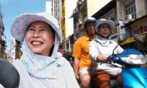 Nữ xe ôm nói tiếng Anh ở phố Tây Sài Gòn