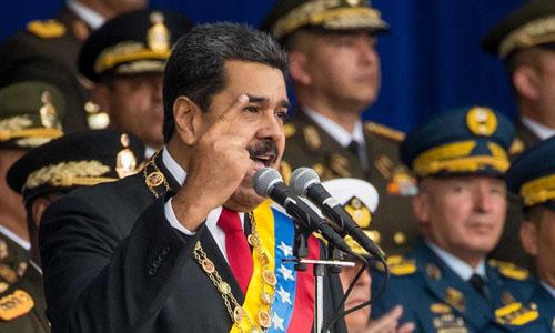 Tổng thống Venezuela Nicolas Maduro phát biểu trong cuộc diễu binh tại thủ đô Caracas hôm 4/8. Ảnh: AP.