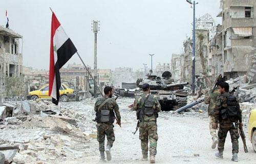 Quân đội Syria tiến vào một thị trấn được giải phóng ở Deraa hồi tháng 6. Ảnh: AFP.