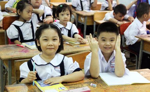 Học sinh lớp 1 ở TP HCM trong ngày tựu trường. Ảnh: Mạnh Tùng.