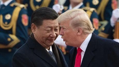 Tổng thống Mỹ Donald Trump (phải) gặp Chủ tịch Trung Quốc Tập Cận Bình ở Bắc Kinh cuối năm ngoái. Ảnh: Reuters.