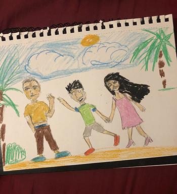 Bức tranh con trai của Bianvẽ về Siam và hai mẹ con cô. Ảnh: BuzzFeed News