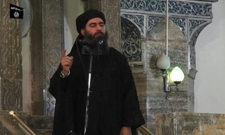 Abu Bakr al-Baghdadi xuất hiện trong video tuyên truyền của IS hồi tháng 7/2014. Ảnh: AFP.