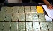 22 bánh heroin trên xe khách vào TP HCM