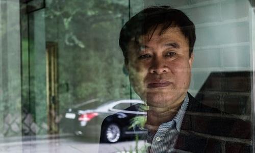 Kim Jong-yong, tài xế kiêm nhà vận động cho quyền lợi người lao động. Ảnh: Guardian.