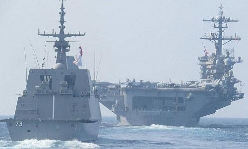 Tàu sân bay USS Theodore Roosevelt (phải) và tàu hộ vệRSS Supreme của Singapore trong đợt diễn tậptại Biển Đông ngày 6/4. Ảnh:Hải quân Singapore.