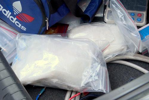 Hơn 2 kg ma túy trong cốp ôtô của Hải. Ảnh: Quang Bình