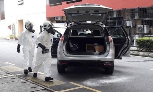 Chuyên viên Ủy ban Giám sát Năng lượng Nguyên tử Malaysia diễn tập ứng phó mối đe dọa phóng xạ hồi cuối tháng 7/2018. Ảnh: AP.