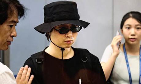 Tomoyuki Sugimoto, công dân Nhật Bản bị Triều Tiên bắt giam hồi đầu tháng, tới sân bay ở Bắc Kinh hôm nay trước khi lên chuyến bay trở về Tokyo. Ảnh: Kyodo.