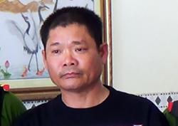 Ông Lê Quốc Bình bị cảnh sát bắt rạng sáng 29/8. Ảnh: Bộ Công an.