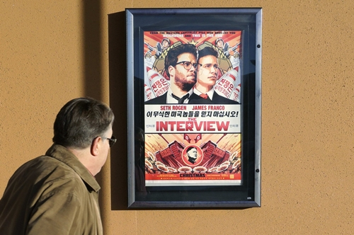 A man walks by the poster for the film
