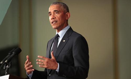 Cựu tổng thống Mỹ Barack Obama phát biểu tại Đại học Illinois ở thành phố Urbana hôm qua. Ảnh: AFP.