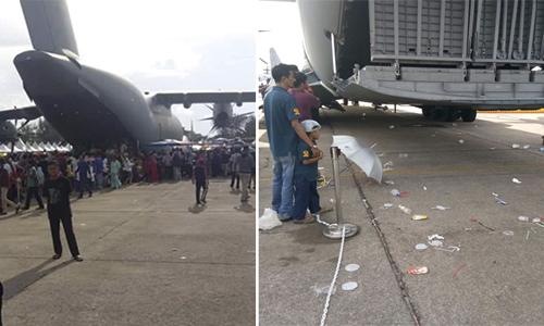 Rác thải vương vãi khắp căn cứ không quân Butterworth ở Penang, Malaysia, sau khi mở cửa cho du khách tham quan hôm 8/9. Ảnh: Facebook.