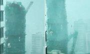 Bão Mangkhut giật gãy cần cẩu khỏi chung cư 22 tầng ở Hong Kong
