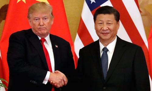 Chủ tịch Trung Quốc Tập Cận Bình (phải) và Tổng thống Mỹ Trump tại Bắc Kinh tháng 11 năm ngoái. Ảnh: Reuters.