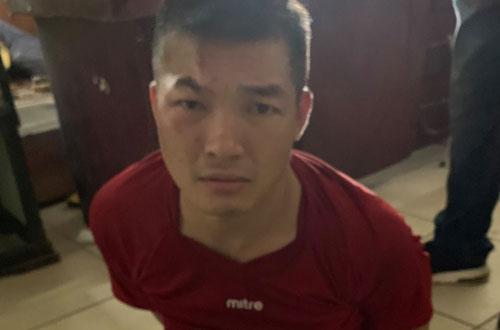 Nghi phạm Nguyễn Văn Quang tại cơ quan công an.
