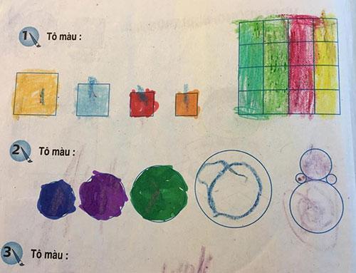 Bài nhận diện hình vuông, hình tròn sách Toán lớp 1 yêu cầu học sinh tô màu trực tiếp. Ảnh: Xuân Hoa