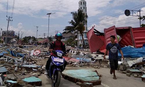 Khung cảnh hoang tàn sau động đất và sóng thần ở Palu. Ảnh: Courier.