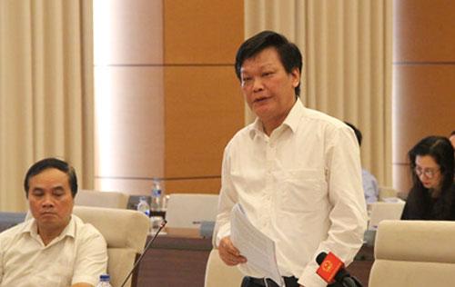 Thứ trưởng Bộ Nội Vụ Nguyễn Duy Thăng giải trình vấn đề thiếu giáo viên và giảm 10% biên chế giáo dục. Ảnh: Sỹ Điền.