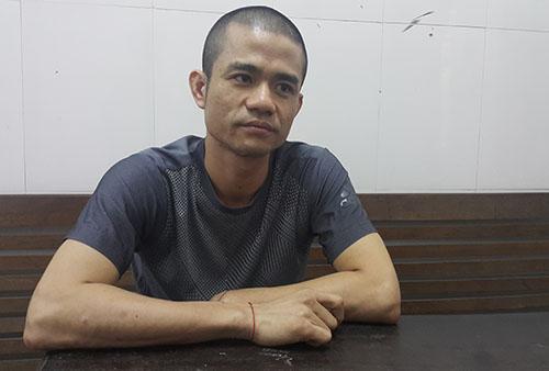 Lê Ngọc Sơn tại cơ quan công an.