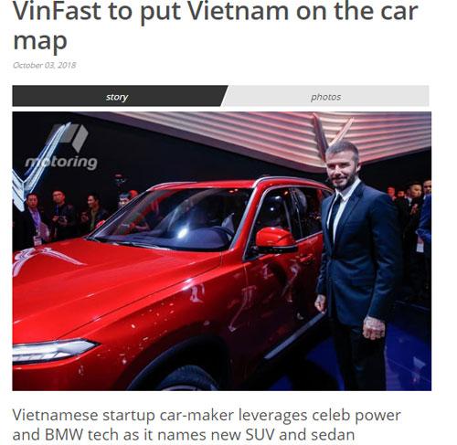 Trang Motoring (Australia) đặt tiêu đề VinFast đưa Việt Nam lên bản đồ ôtô kèm ảnh chụp cựu danh thủ Anh David Beckham bên cạnh mẫu SUV Lux SA2.0 của VinFast tại buổi ra mắt ở Paris. Ảnh chụp màn hình.