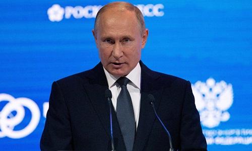Tổng thống Nga Vladimir Putin tại diễn đàn về năng lượng tổ chức ở Moskva ngày 3/10. Ảnh: Sputnik.