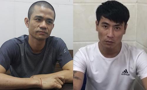 Lê Ngọc Sơn và Hoàng Ngọc Sinh (bên phải) tại cơ quan điều tra.