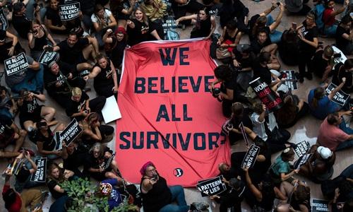 Những người tham gia cuộc biểu tình ở Washington ngày 4/10. Ảnh: AFP.