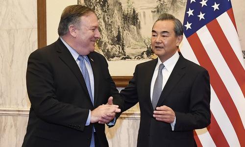Ngoại trưởng Mỹ (trái) gặp Ngoại trưởng Trung Quốc tại Bắc Kinh hôm 8/10. Ảnh: AFP.