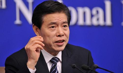 Bộ trưởng Thương mại Trung Quốc Chung Sơn trong cuộc họp báo bên lề Kỳ họp thứ nhất Quốc hội Trung Quốc khóa 13, tháng 3/2018. Ảnh: Reuters.
