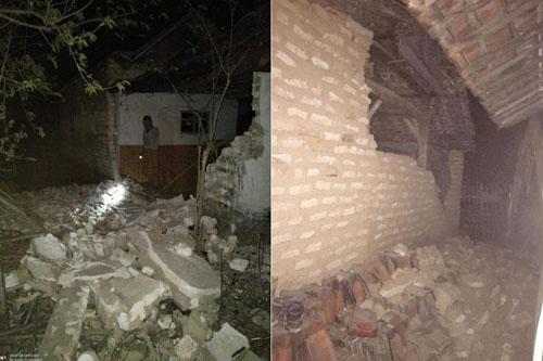 Những ngôi nhà bị phá hủy ở tỉnh Đông Jva sau trận động đất sáng nay. Ảnh: BNBP