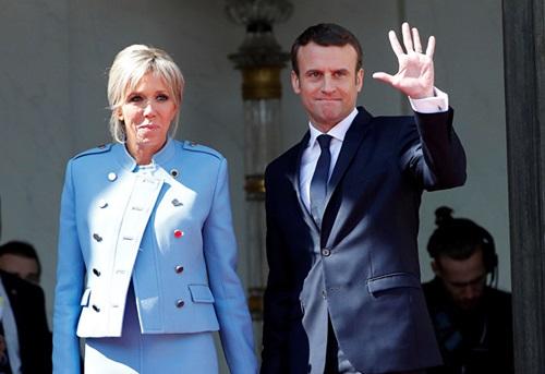Tổng thống Pháp Emmanuel Macron và vợ, Đệ nhất phu nhân Brigitte Macron. Ảnh: Reuters.