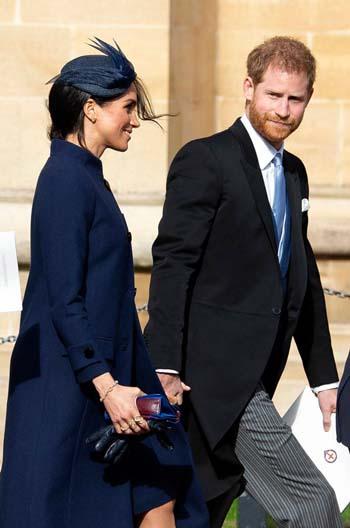 Hoàng tử Harry và Công nương Meghan tại đám cưới công chúa Eugenie hôm 12/10. Ảnh: Wireimage.
