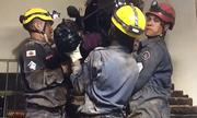Lính cứu hỏa Brazil giải cứu tên trộm kẹt trong ống khói