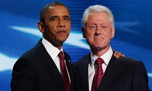 Obama (trái) và Bill Clinton tại Charlotte tháng 9/2012. Ảnh: AFP.