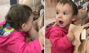 Em bé cố bú sữa từ áo lót trong siêu thị Mỹ
