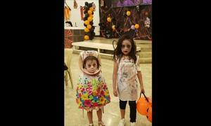 Bé 2 tuổi ở Philippines hóa trang mất đầu đi xin kẹo lễ Halloween
