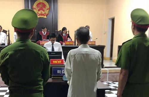 Phiên tòa xét xử ông Nguyễn Quang Chung. Ảnh: Nghi Xuân.