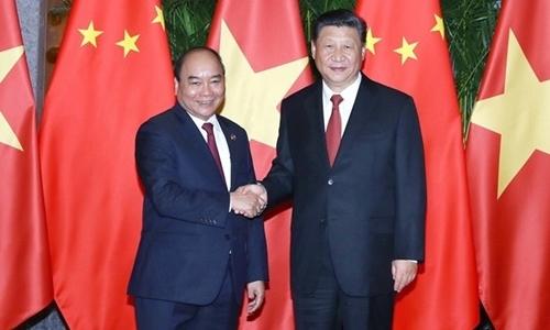 Thủ tướng Nguyễn Xuân Phúc và Chủ tịch Trung Quốc Tập Cận Bình. Ảnh: VGP.