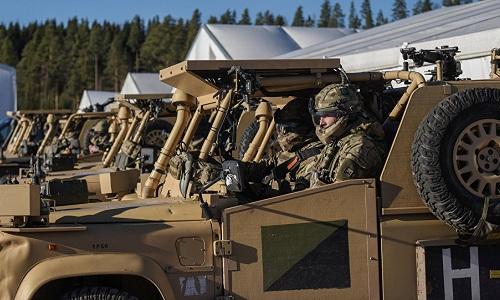 Các xe quân sự NATO tham gia tập trận Trident Juncture 18. Ảnh: Reuters.