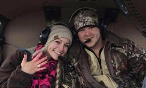 Will Byler và Bailee Ackerman chụp ảnh trong một chiếc trực thăng sau khi Byler cầu hôn. Ảnh: Facebook.